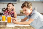 Kids laughing at breakfast